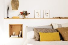 03 a mustard pillow and blanket make a bold colorful statement and add cheerfulness to the space