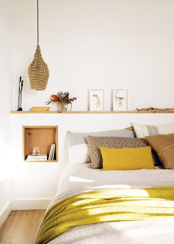 a mustard pillow and blanket make a bold colorful statement and add cheerfulness to the space