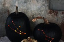 03 stylish black drilled pumpkins with lights inside instead of usual spooky carved ones