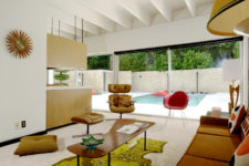 04 Here's a second sitting space with comfy leather furniture and colorful touches here and there