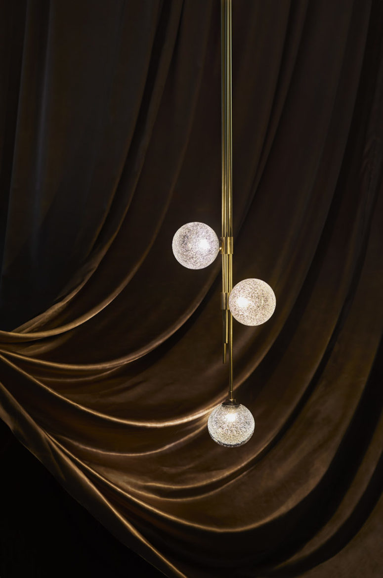 The Trilogy pendant light features three glass spheres that look really intricate and catchy