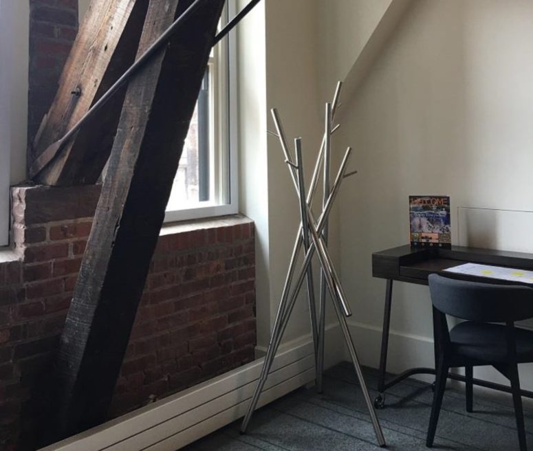 The coat rack is a combo of stainless steel sticks, that's why it's called so