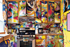 04 The kitchen looks like a crazy space, all painted bold colors in crazy combos with a waterolor effect