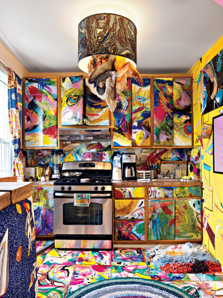 The kitchen looks like a crazy space, all painted bold colors in crazy combos with a waterolor effect