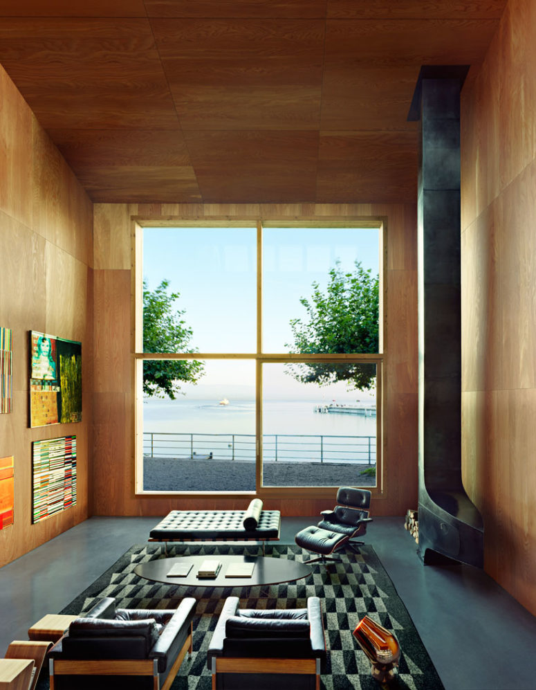 The living room is done with a giant window that lets enjoy the views and fills the space with light