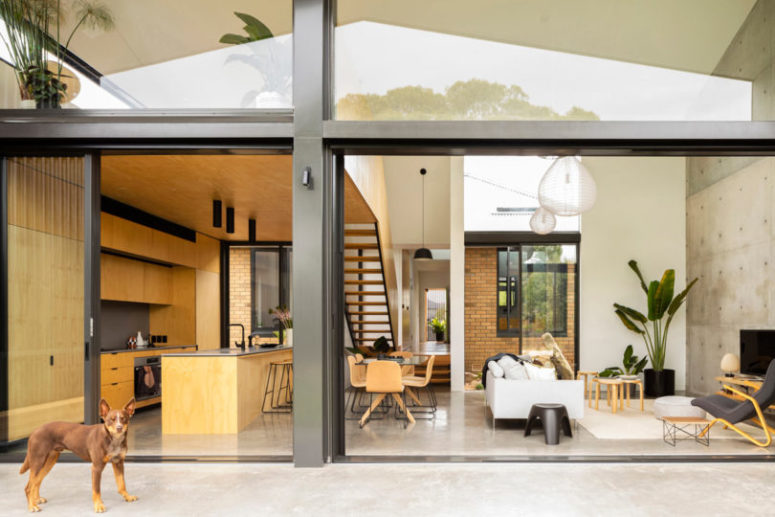 The main space is an open layout with a dining, living space and a kitchen all in one