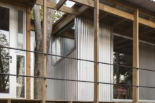 04 There are many windows and the trees are incorporated into the house contruction seamlessly