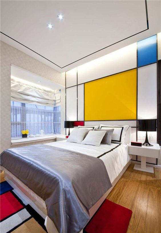 a color block headboard wall and a matching rug is a great idea to fill your bedroom with color in a stylish way