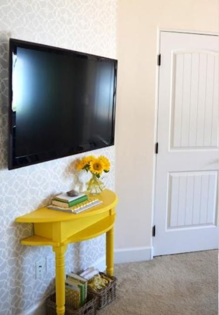 a comfy TV console of a half cut table painted bold yellow will provide some storage without taking much space