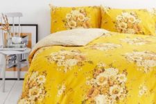 yellow print bedding to add a touch of color to a bedroom