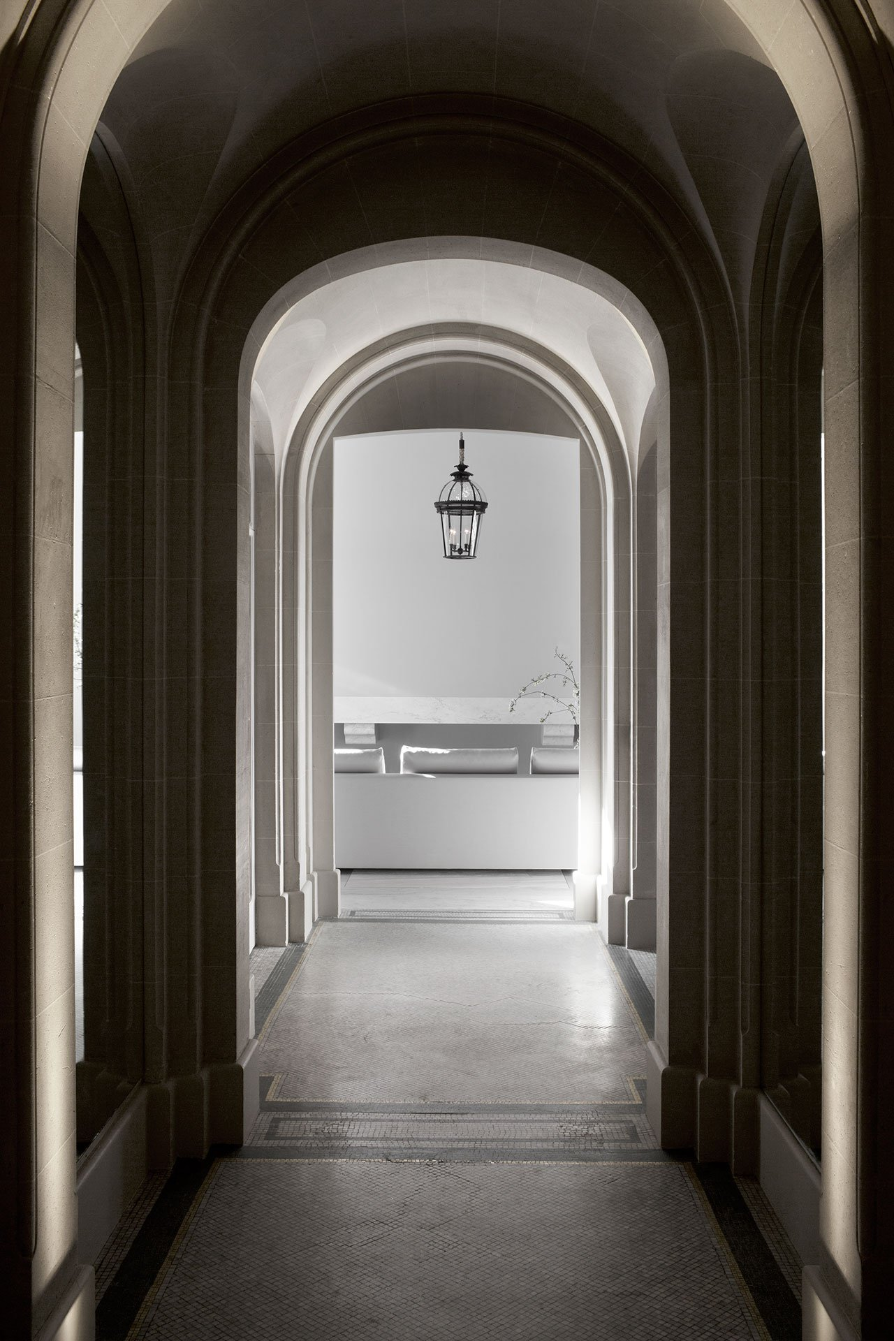 Arched windows and walkways add elegance to the apartment