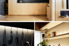 05 The kitchen is a light-colored wood unit with black marble for a contrast