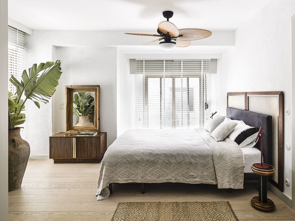 The master bedroom is done with a large comfy bed and framed screens to highlight the headboard