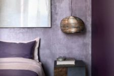 05 a bold color blocked bedroom with a bright purple wall and lavender plaster ones for an enchanting look