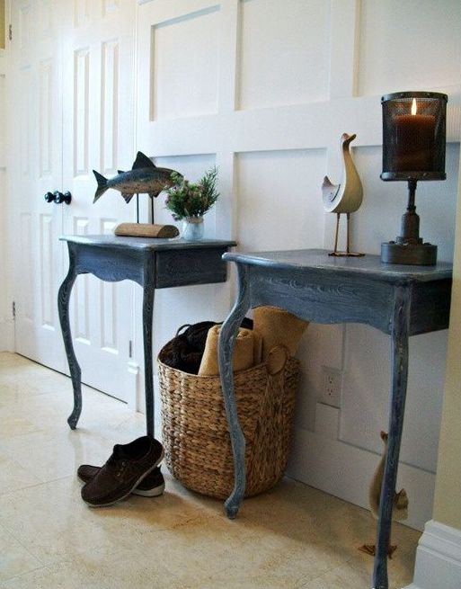 a duo of entryway consoles made of a vintage table cut in halves and painted blue