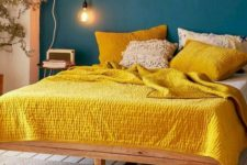 05 a teal wall and bright yellow bedding create a super bold contrast and a wow look