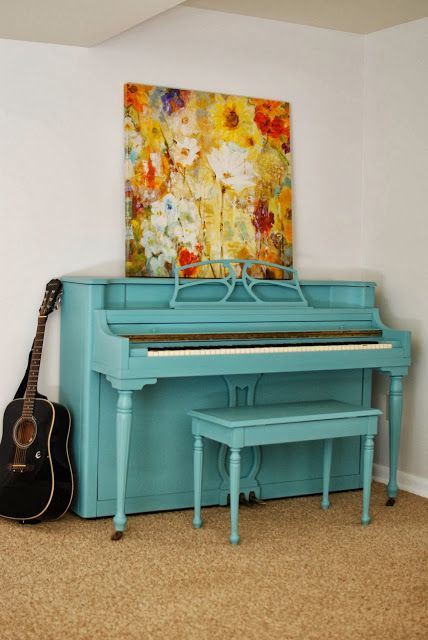 an egg blue piano and a bold contrasting floral artwork will add color and interest to the nook