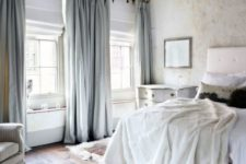 05 heavy grey silk curtains match the bedroom decor and make the space warmer keeping the cold away