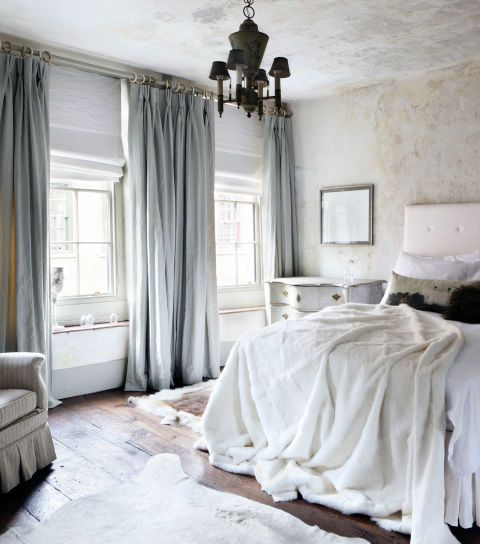 heavy grey silk curtains match the bedroom decor and make the space warmer keeping the cold away