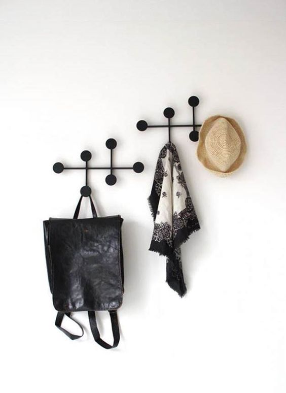 modern black metal dot coat racks that are wall-mounted are a great idea for a modern space