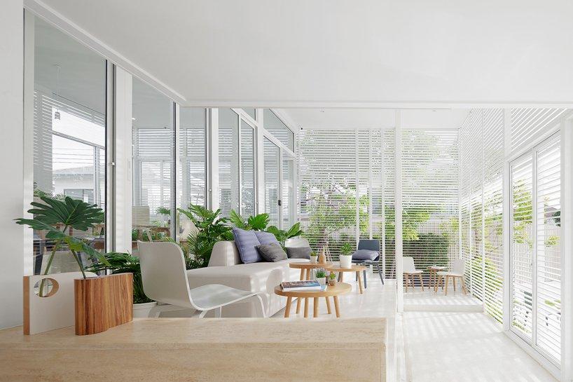 coastal inspired sunroom design in white tones
