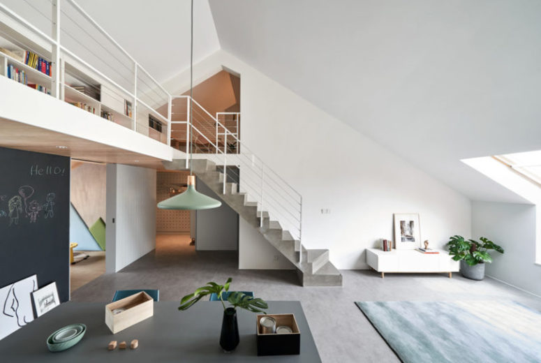 The concrete staircase looks architectural and chalkboard panels cover the kid's space