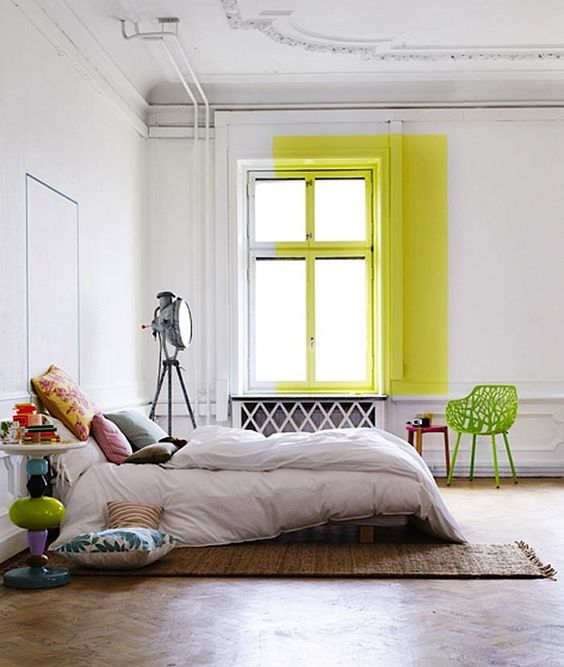 a bold idea to add color to the bedroom, a neon yellow touch on the window to make a statement