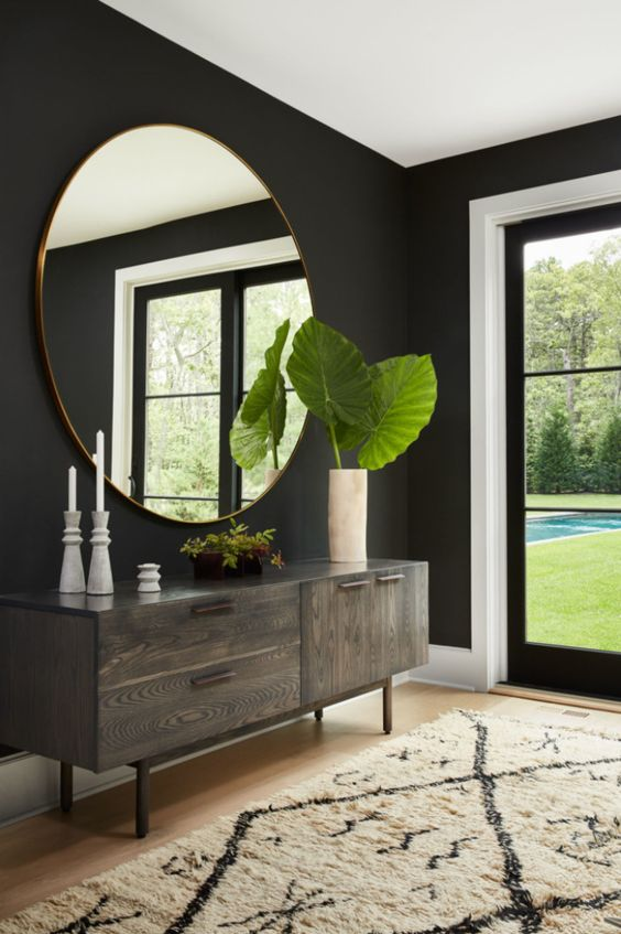 a statement oversized mirror is another cool idea to fill in a blank wall