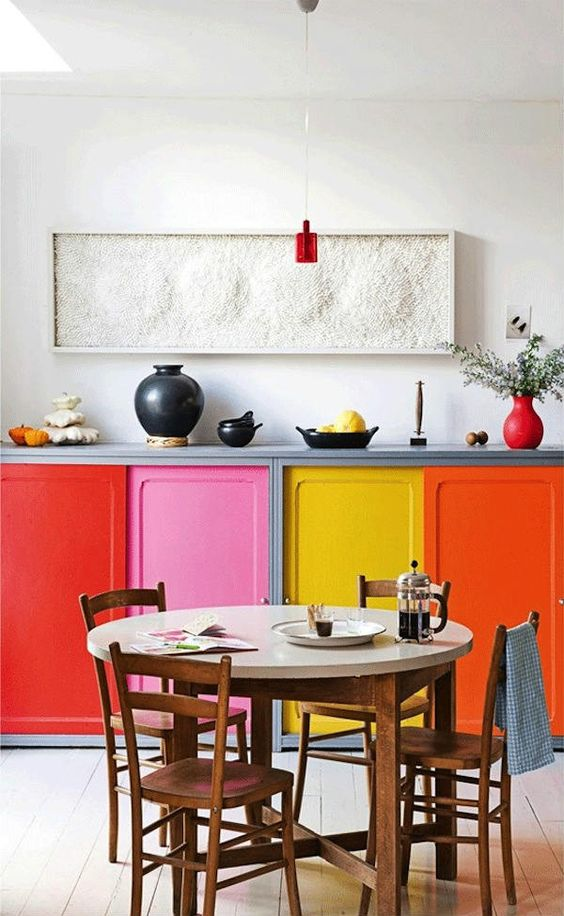 jazz up even the tiniest kitchen with bright cabinets, each of a different color and shade