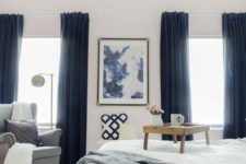 06 thick navy curtains add a touch of drama to the room and tone down the natural light making the bedroom cozier