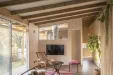 07 The decor and furniture are mid-century modern with a boho feel and there's much greenery