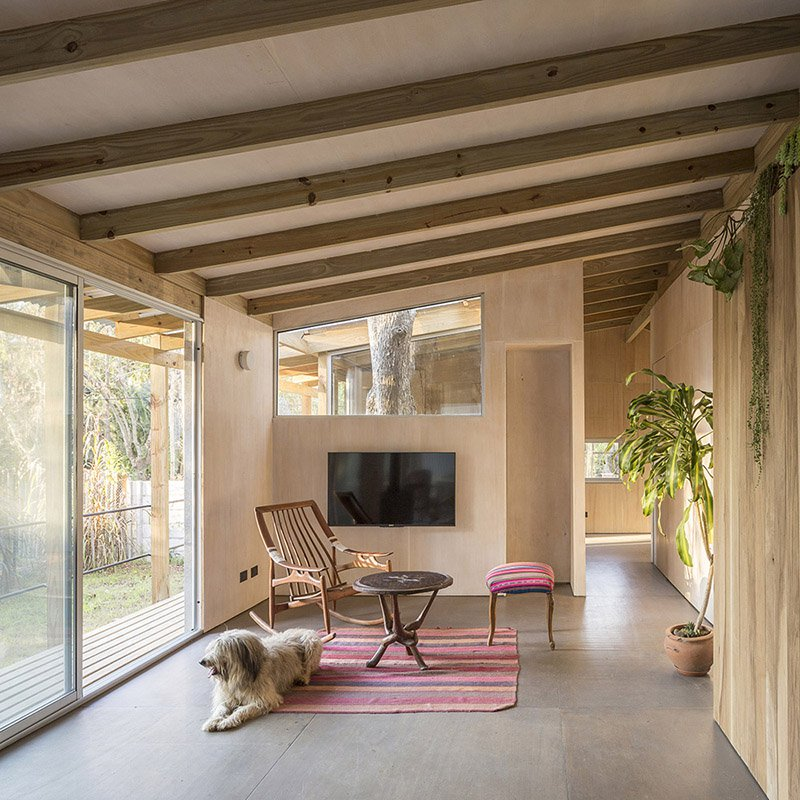 The decor and furniture are mid century modern with a boho feel and there's much greenery