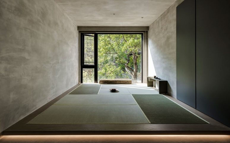 This is a meditation room with a gorgeous natural view and traditional Japanese mats on the floor