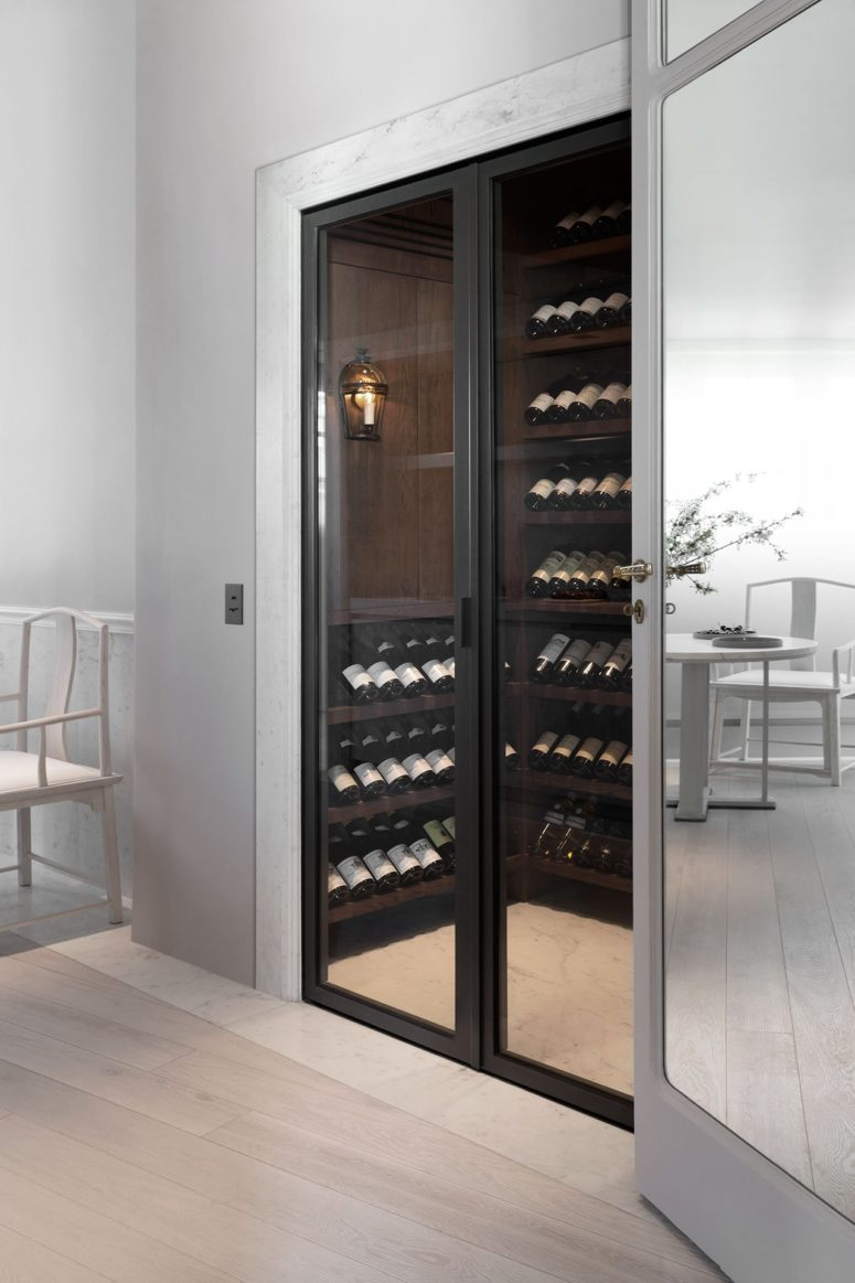 You may see a small modern wine cellar in the kitchen, too