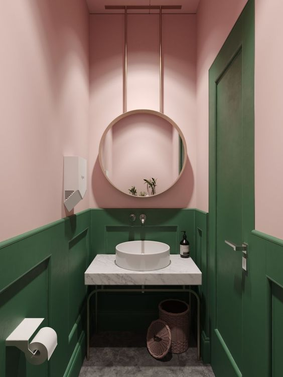 a combo of green and blush is a cool and bold idea to try in a bathroom or a powder room