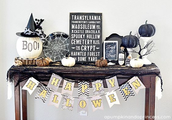 a console with black and white spiderweb, lots of pumpkins, signs and branches
