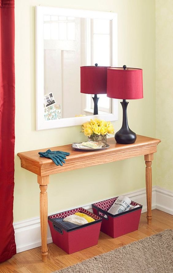 a simple wooden half table as an entryway console will hold everything you need