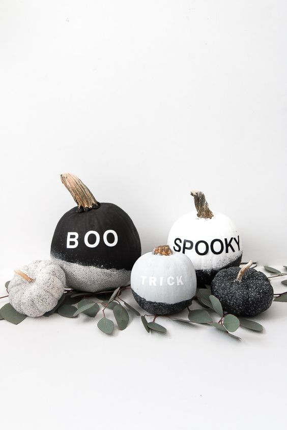 make a display of cool  black and white glitter pumpkins with vinyl letters - they are veyr easy to DIY