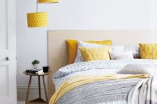07 yellow printed lampshades echo with pillows and a blanket and add color to the neutral space