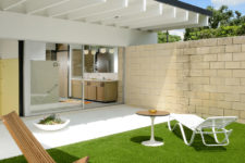 08 The outdoor space includes some loungers, sitting zones and a perfect lawn