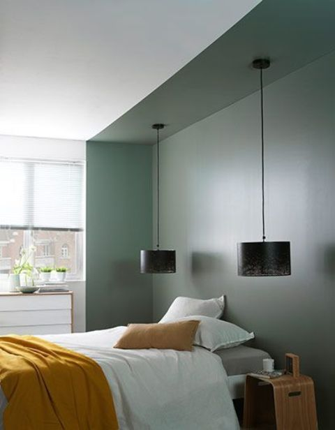 a dark green bedroom niche in a neutral bedroom brings color and makes a statement