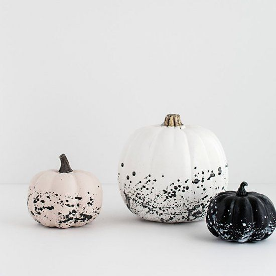 modern black and white splatter pumpkins can be easily DIYed for Halloween decor