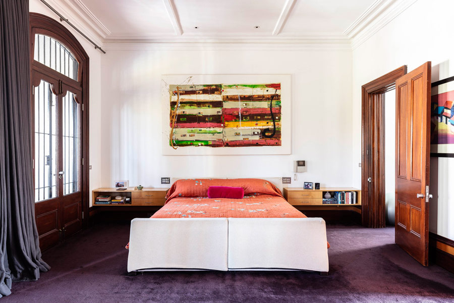 The guest bedroom is bright and colorful, in coral, plum, orange and green and it's more private