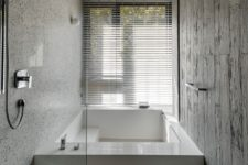 minimalist bathroom design with a sunken bathtub