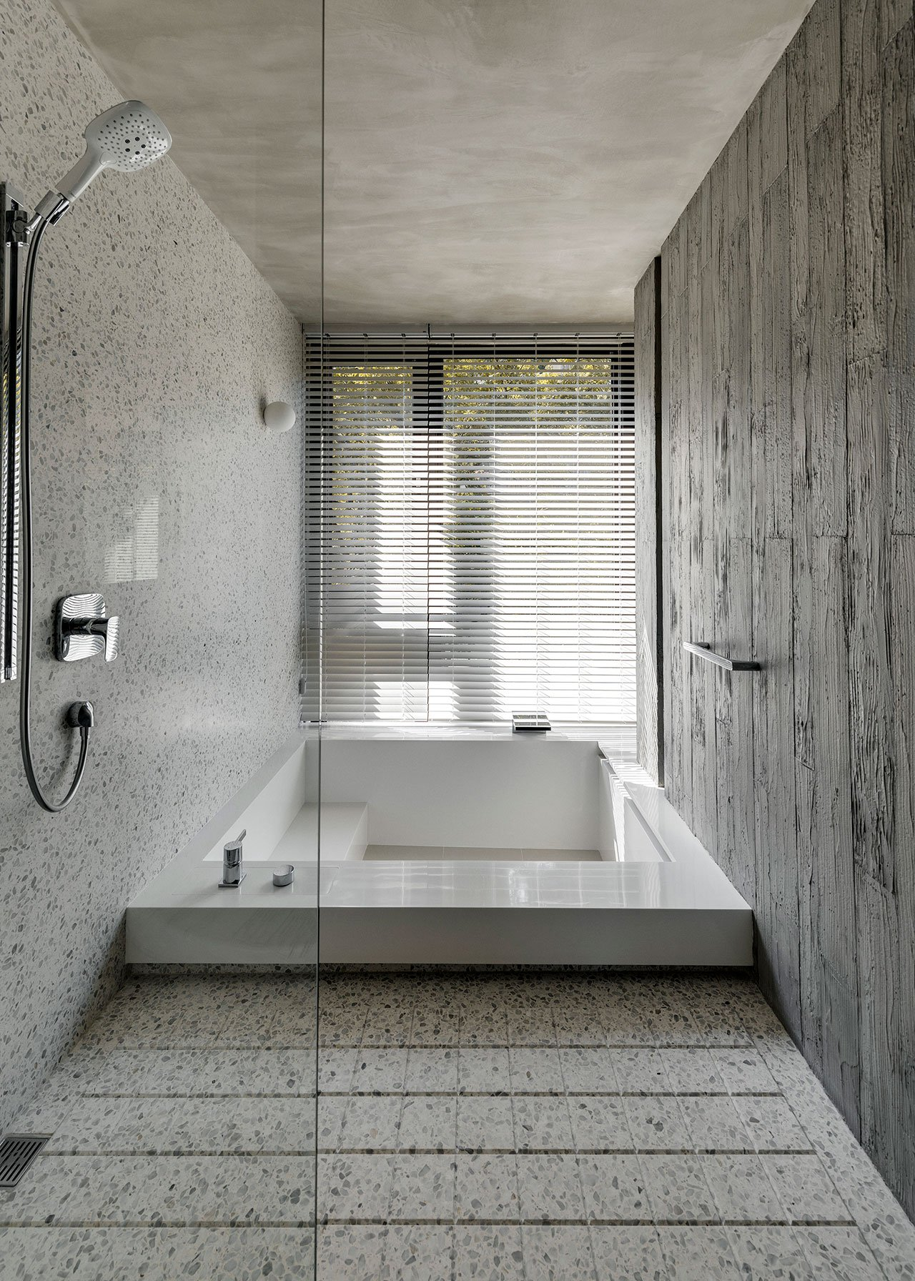 minimalist bathroom design with a sunken bathtub