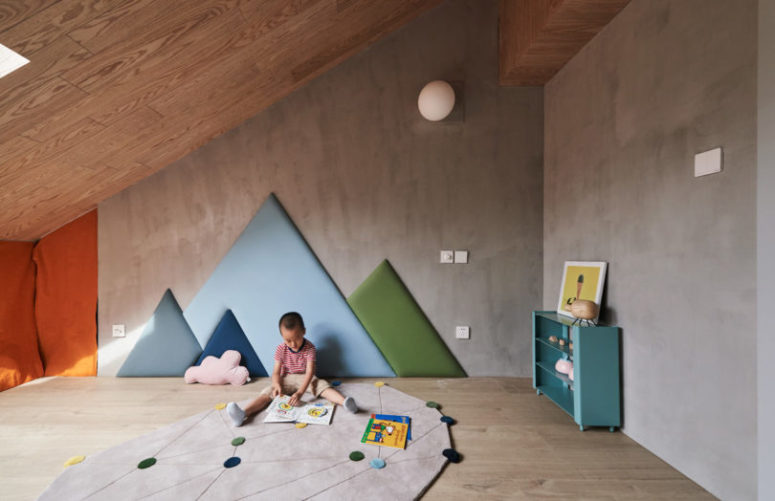 The other walls are clad with concrete for a more minimalist look
