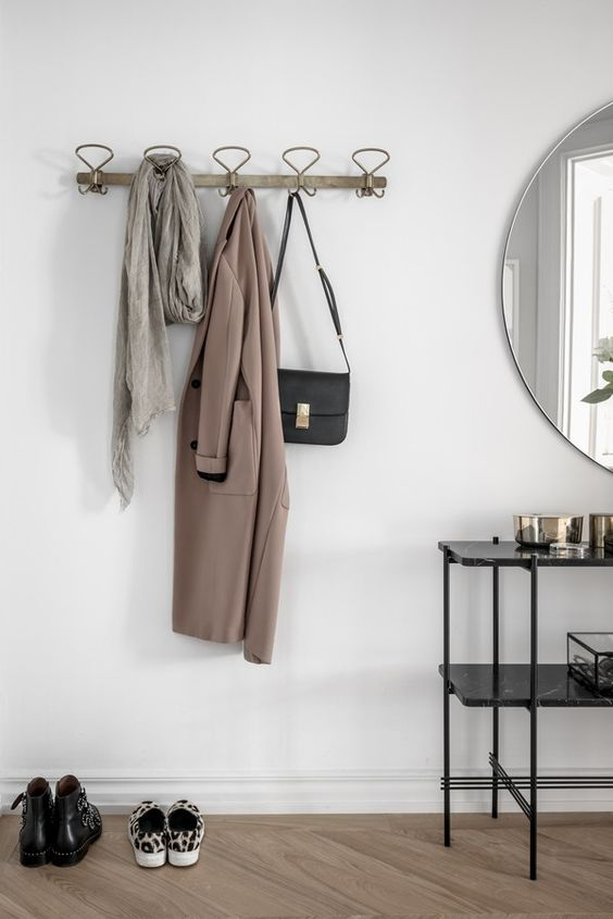 a comfy coat rack with loops and a wooden base looks ethereal and is great for hanging everything you want