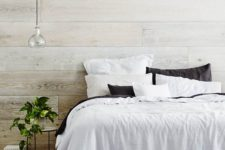 09 a cozy rustic bedroom with whitewashed walls and a floor – it's a great base for adding warmth and coziness