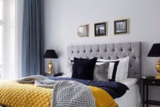 09 a grey and blue bedroom spruced up with a yellow blanket for a bright and cheerful look