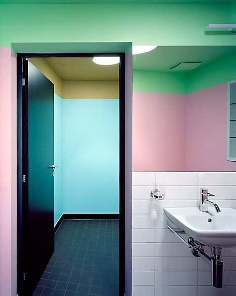 a mix of green and pink with a color block effect and some white tiles to make the look less crazy